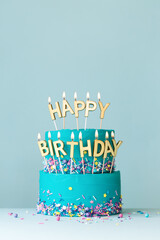 Turquoise birthday cake with golden candles