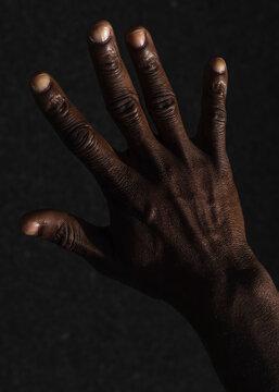 Hand details of a black man