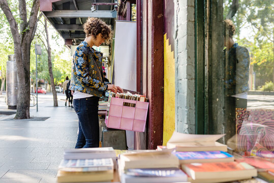 woman looking at records in a second hand shop
