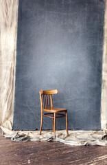 wooden vintage chair in studio on grey background
