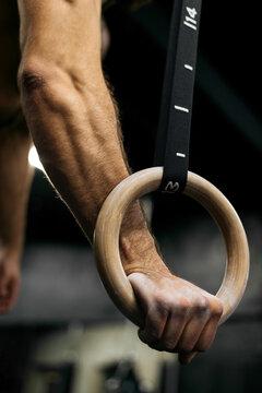 Handsome athlete gym training