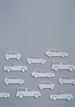 Paper car on grey background