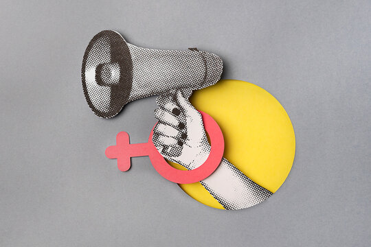 HAND HOLDING A BULLHORN WITH A FEMALE SIGN