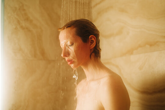 Woman With Short Hair taking shower
