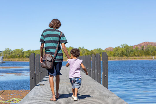 woman and child walking down jetty at Lilly Creek Lagoon