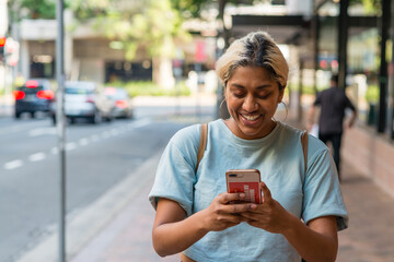 woman using phone in the city
