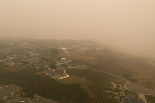 Aerial of Bandon Oregon during wildfire season 2020 with brown ash filled air