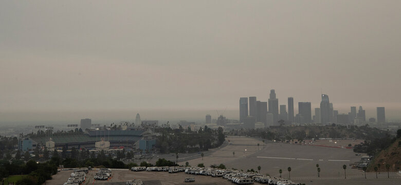 Dodger Stadium and downtown are pictured from Angels Point in a smoke haze generated by the Bobcat fire in Los Angeles