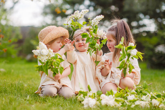 portrait of three children in the spring in nature