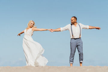 happy newly married couple dancing on the beach. Wedding on the beach