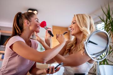 Two girls having fun at home