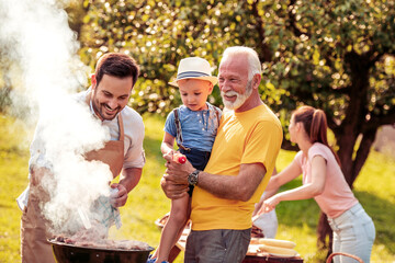 Family make barbecue together.