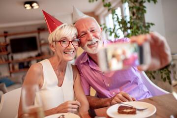 Senior couple celebrating birthday.