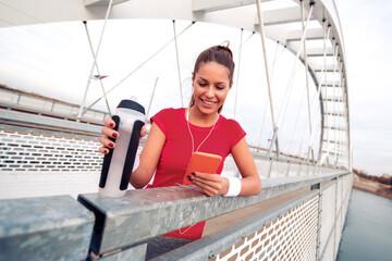 Female runner jogging over the bridge