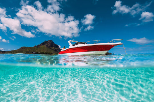 Tropical ocean water with sandy bottom and motor boat