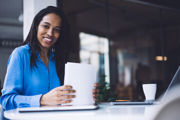 African American female freelancer working in office