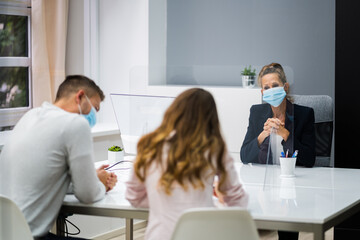 Young Family Couple Meeting Consultant Or Lawyer