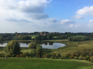 Bucolic landscape seen from Framlingham Castle in the county of Suffolk England with lake, lawn and trees