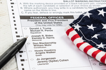 Official 2020 US Election absentee mail in ballot with a mask and a black pen focused on the presidential candidates with a shallow depth of field and copy space