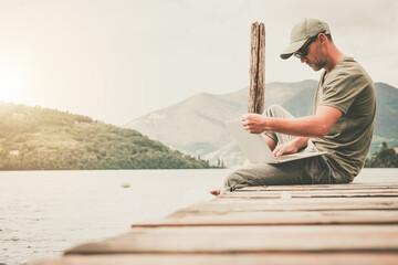 Working Businessman Online From Wooden Lake Pier