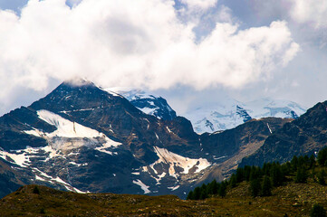 Swiss Mountains and glacier lakes as seen from the Bernini Express Train  from Italy to St Moritz in Switzerland,which is a journey full of wonderful scenery, mountain peaks and deep valleys