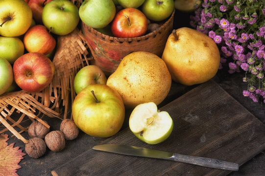 Autumn still life with apples and pears