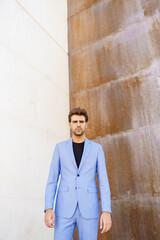 Attractive man wearing suit standing in urban background.
