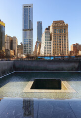 New York City - april 15: The One World Trade Center and memorial site in New York with blue sky on April 15, 2016