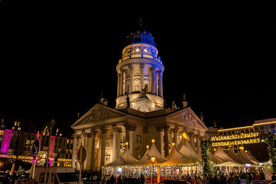 The French Church of Friedrichstadt and Christmas market at the Gendarmenmarkt by night. Berlin
