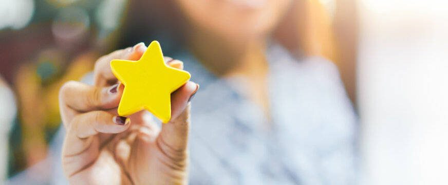 Customer Experience Concept, Best Excellent Services for Satisfaction present by Hand of Client giving a Star Rating.Woman Giving Star Feedback.Clients Choosing Satisfaction Rating.Customer Service.