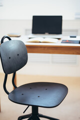 Empty work space chair, desk with laptop