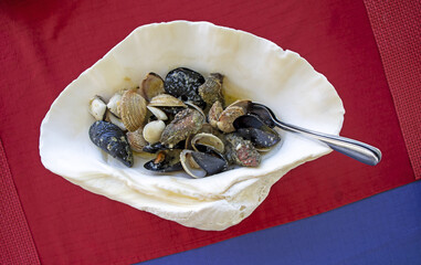 Delicious dish of mixed shellfish served in a large shell