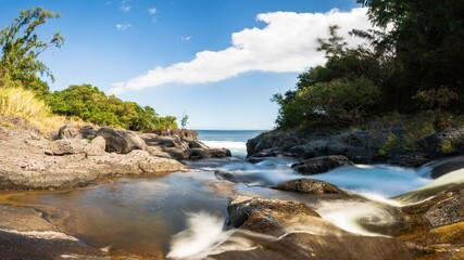 Long exposure of river and rocks to the sea, Reunion Island