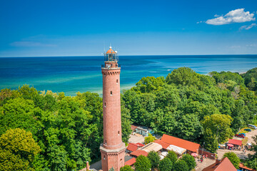 Aerial view of lighthouse on sunrise by Baltic Sea