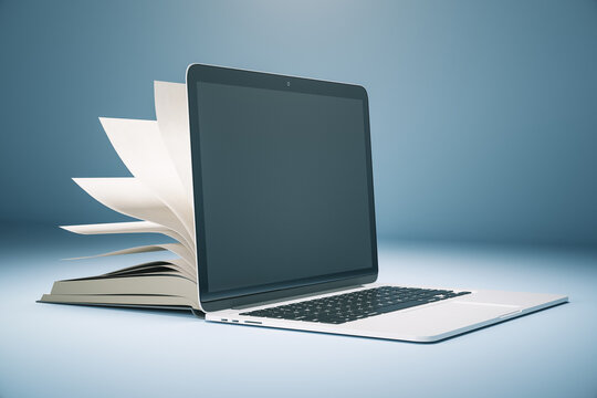 Abstract book and open laptop.
