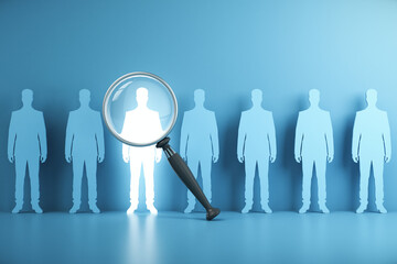 Magnifying glass focusing on white silhouette businessman standing with many blue people.