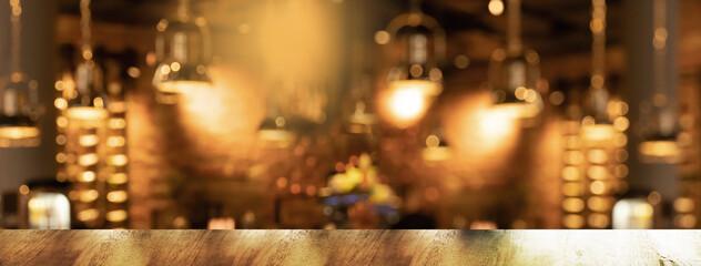 Obraz golden lamp with blur bar or pub party at night orange light city interior banner background - fototapety do salonu