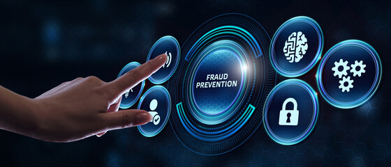 Business, technology, internet and networking concept. Young businessman working on his laptop in the office, select the icon Fraud prevention on the virtual display.