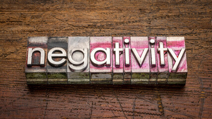 negativity word abstract in gritty vintage letterpress metal type  against rustic, weathered wood, work, stress, mindset  and lifestyle concept
