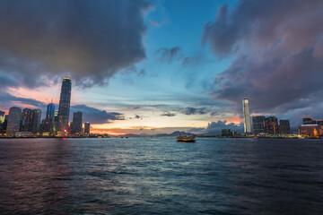 Fototapete - Panorama of Victoria harbor of Hong Kong city at dusk