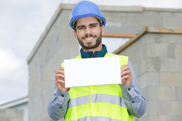 engineer man construction worker holding blank advertising banner