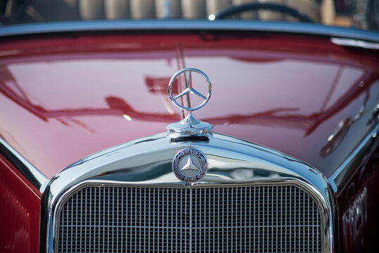 Mulhouse - France - 13 September 2020 - Closeup of vintage Mercedes logo on  front car parked in the street