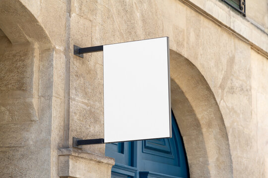 Shop sign Mockup. Rectangular storefront on a wall in street template
