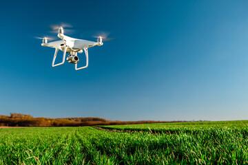 drone quad copter on green corn field