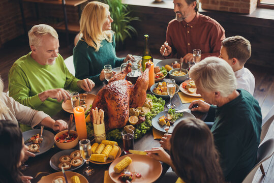 Holiday feast table family relatives gathering thanks giving dinner communication living room indoors