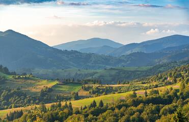 Beautiful sunset on the background of the mountain landscape. Carpathians.