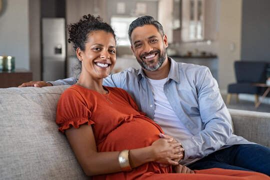 Pregnant african woman with husband at home