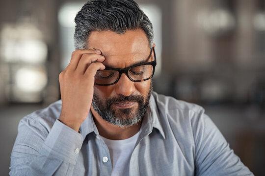 Stressed ethnic man with headache