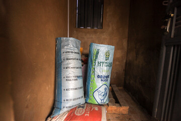 Two bags of chicken feed are seen in a storage of a poultry farmer in Kubwa Abuja