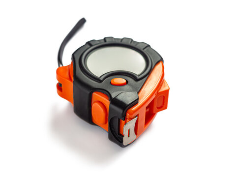 Measuring tape in an orange and black plastic case, with a metal ruler, on a white background